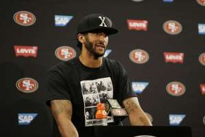 Kaepernick wearing a shirt with images of dictator Fidel Castro (SFGate, Ben Margot, Associated Press)